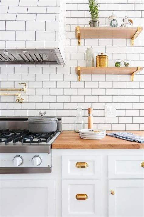 white kitchen cabinets with copper cup pulls and copper sink transitional kitchen lovely kitchen features white cabinets adorned with