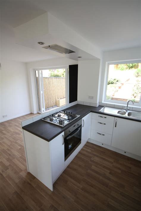 stove with built in exhaust fan gloss white kitchen peninsular units with flush ceiling