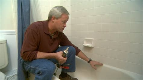 best way to caulk a bathtub how to caulk around a tub today s homeowner