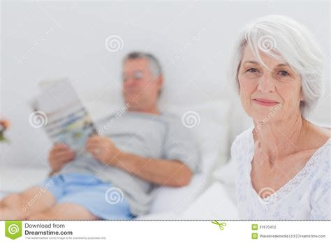 granny bed smiling mature woman sitting in bed stock photography image 31670412