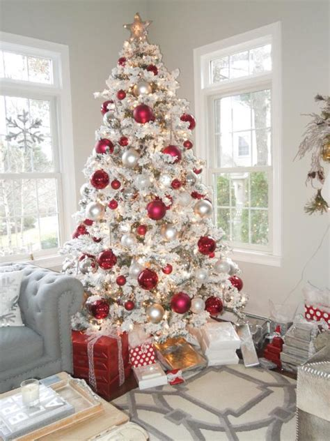 white decorations for a tree decorate a festive flocked tree