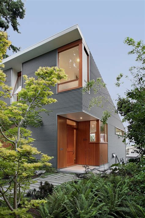 shed style architecture corrugated steel house with warm wood details throughout