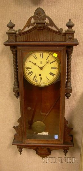 oak howard miller clock coffee table bidsquare