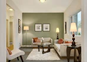 Small living room with green colored accent wall livinator