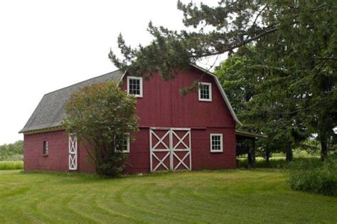 reduced door county home for sale with 50 acres barn and