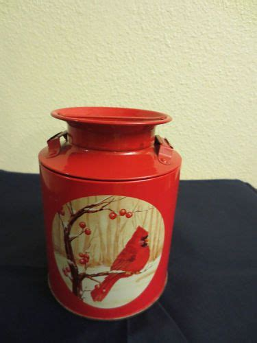 milk cans cardinals and tins on