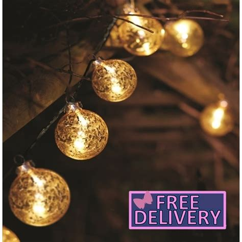 gold stellar glass bauble string light the garden factory