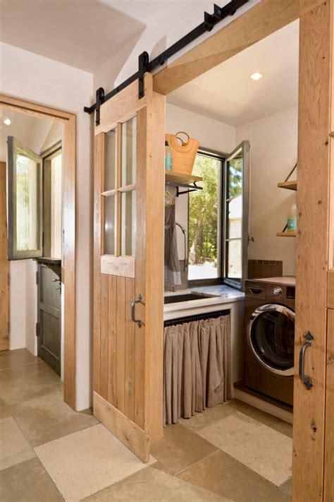 The House Enthusiast Inspiration Barn Doors Barn Door Laundry Room