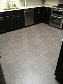 tiled kitchen floor set brick pattern vip services