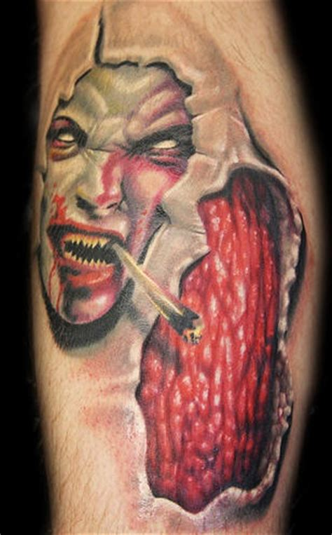 smoking demon and flesh under skin rip tattoo