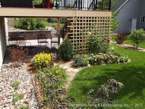 Deck Landscaping Ideas Paver Patio Deck With Retaining Wall Steps Minnesota Landscaping Ideas By Switzer S