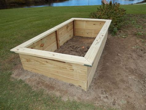 raised bed construction raised bed construction made with 2 quot x 12 quot 4 x 8 treated lumber beginning of my