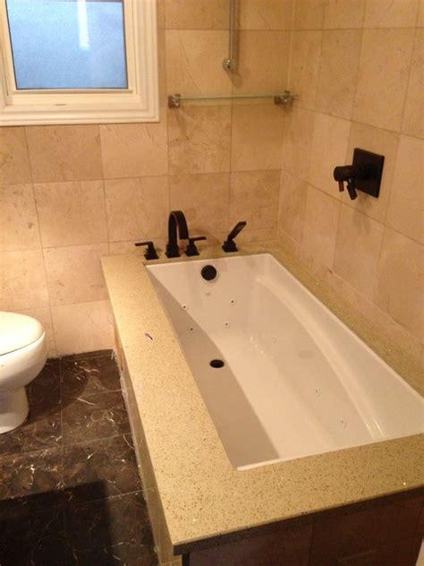 quartz bathtub undermount tub with quartz deck designed and installed