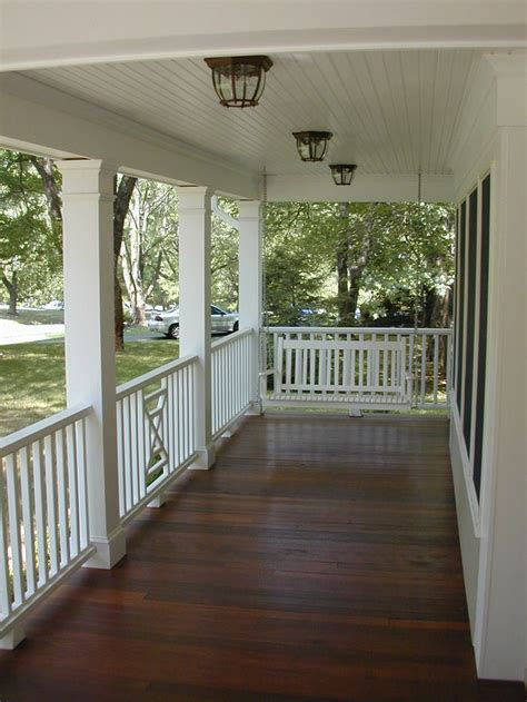 covered front porch designs dark stained porch white rails new house outside porch