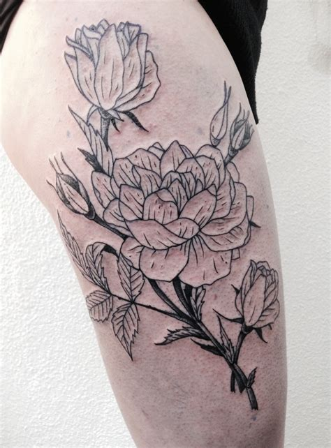 floral leg tattoo designs black flower on thigh