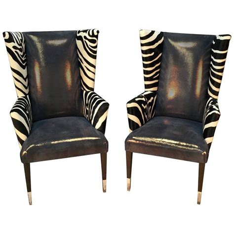 pair of modern wingback chairs in zebra printed cowhide