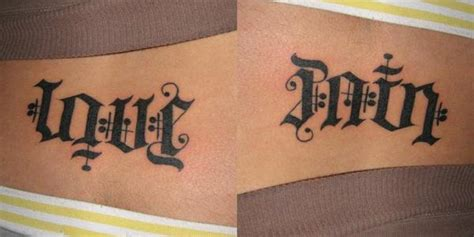 love and pain tattoo designs ambigram on lowerback