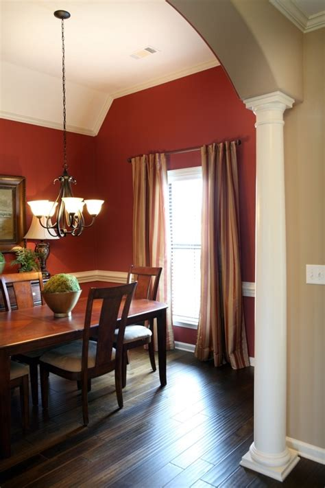 Warm Dining Room Colors by Dining Room With A Splash Of Color And Gold Curtains