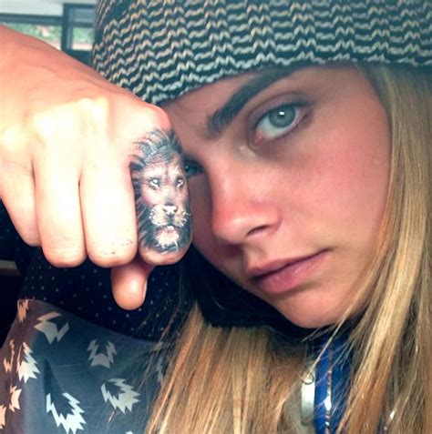 lion finger tattoo tumblr cara delevingne dishes on the meaning behind her tattoos