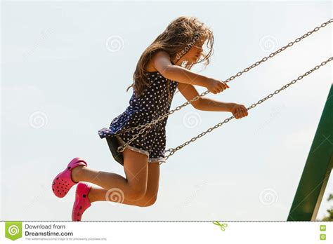 swinging on a swing girl swinging on swing set stock image image of active