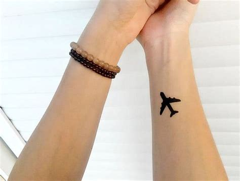small silhouette tattoo 29 attractive aeroplane wrist tattoos