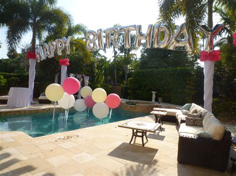 backyard birthday party ideas birthday balloon arch over a swimming pool backyard party
