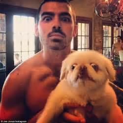 joes dogs joe jonas shows posts his own shirtless photo after younger nick put his buff