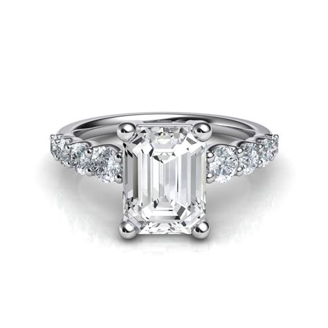 graduated side emerald cut engagement ring