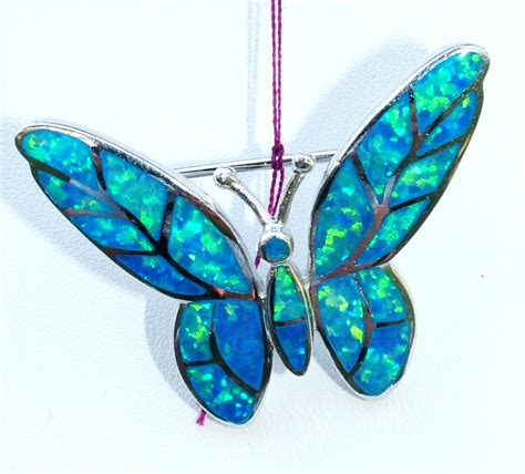 gorgeous blue precious opal butterfly pendant