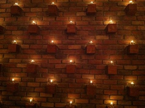 exposed brick wall lighting using bricks as candle holders actually cementing the