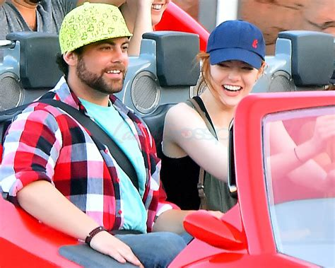 emma stone brother emma stone looks happy at disneyland with her brother amid