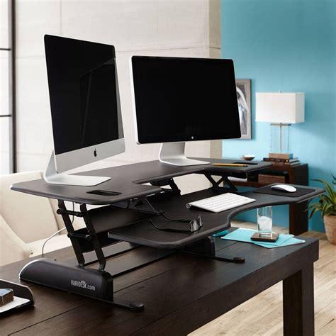 varidesk height adjustable standing desk the varidesk pro plus 48 is a height adjustable standing
