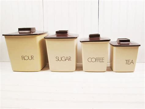 brown kitchen canister sets vintage canister set plastic brown lid typographic