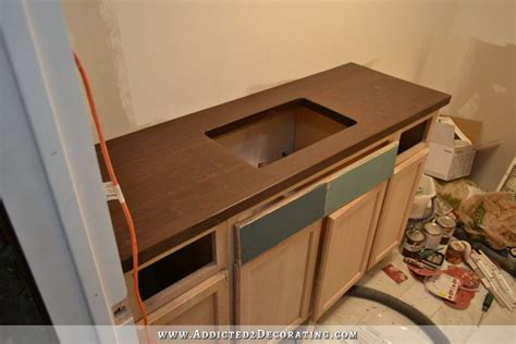 stained diy butcherblock countertop with an