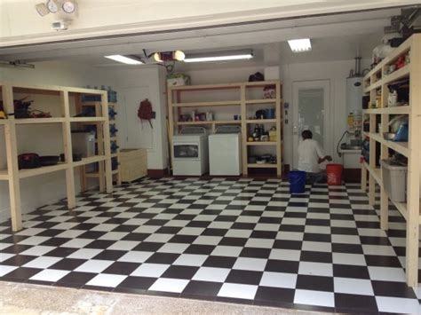 garage remodel with custom cabinets and checkered floor in