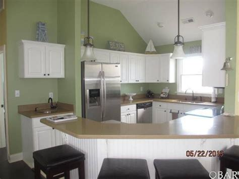 kitchen white cabinets green walls beach house