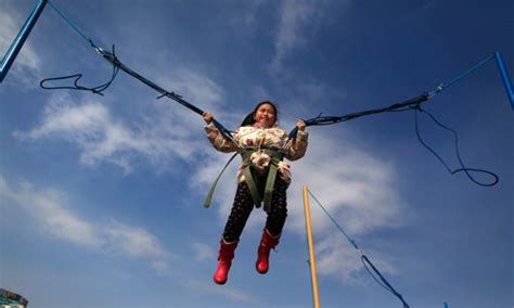 bungee swing springing in to the new year a chinese girl plays on a