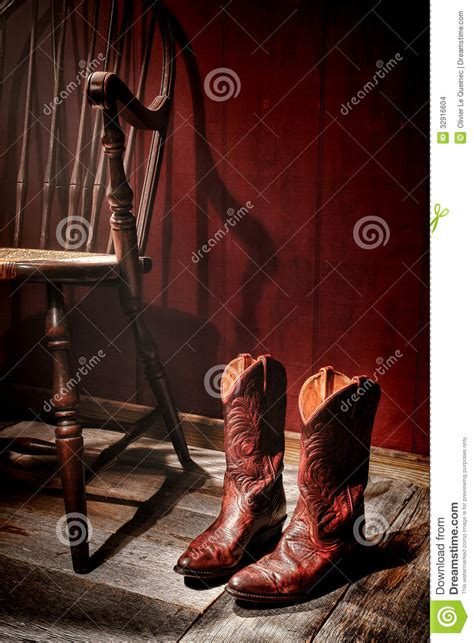 Country Cabin Plans american west rodeo cowgirl boots and old chair stock