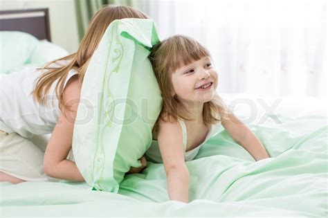 two girls in bed two girls playing in bed stock photo colourbox