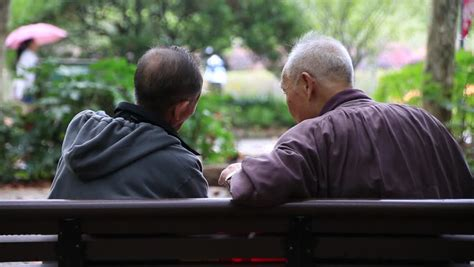talking bench shanghai nov 07 2015 two asian senior men talking while
