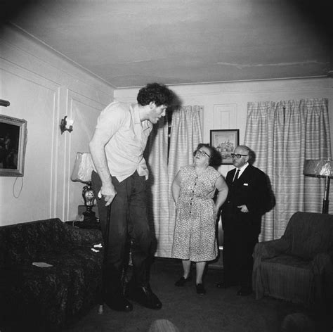 triplets in their bedroom nj 1963 diane arbus a jewish giant at home with his parents in the bronx new york 1970 169