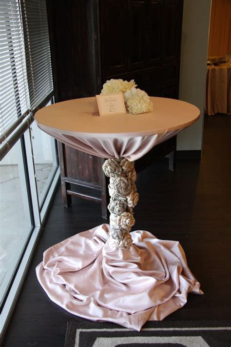 Cocktail table with rosettes. Love!   Wedding Ideas