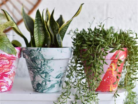 homemade flower pots ideas diy bright marbled pots using nail polish hgtv s