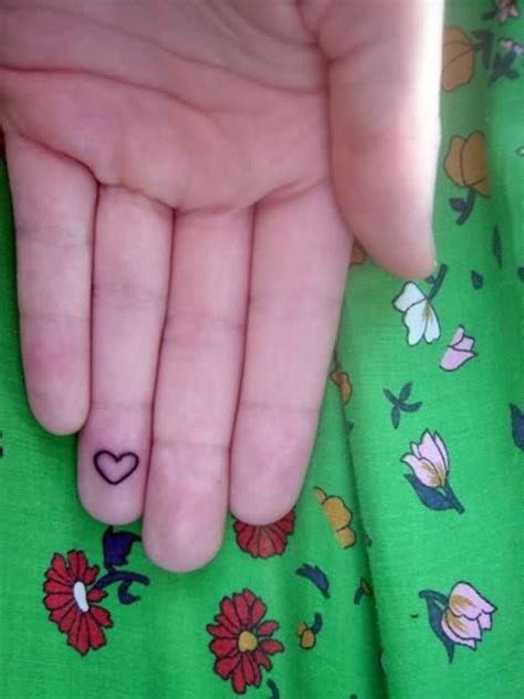 heart tattoo on finger 43 awesome hearts tattoos on finger