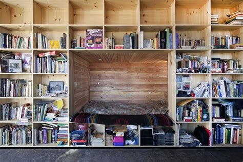Wall To Wall Shelving Nakai House In Utah Features Wall Of Shelves With Bedroom