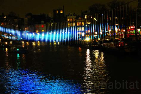 amsterdam s annual light festival sets the city aglow with