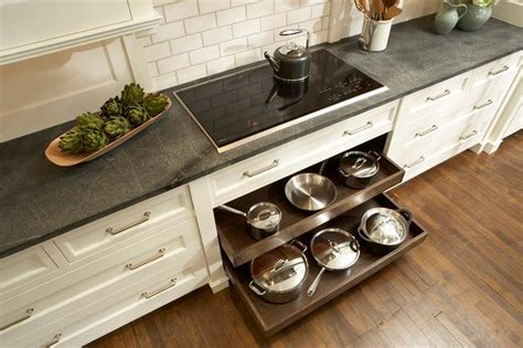 kitchen pull out drawers for pot storage front porch cozy pot and pan drawers below cooktop transitional kitchen
