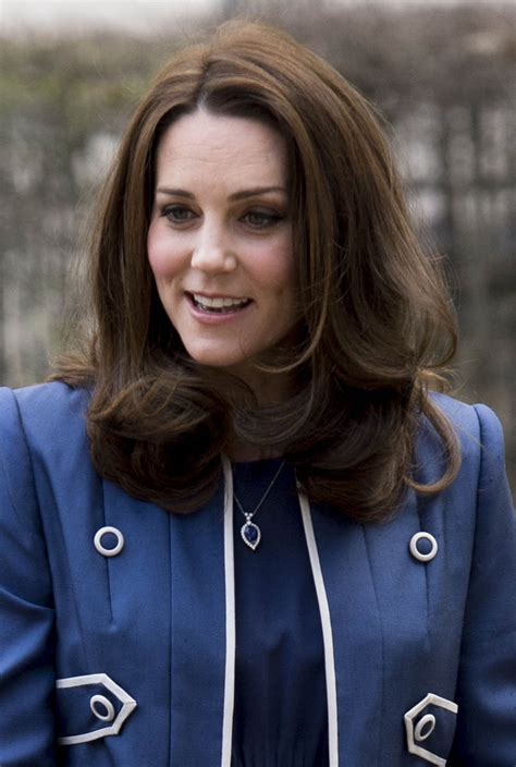 Princess Kate giggles during visit to Royal College of