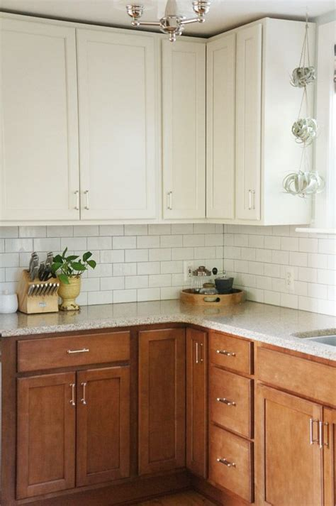 two tone maple kitchen cabinets two tone kitchen reveal white cabinets darker wood base lowers and subway tile