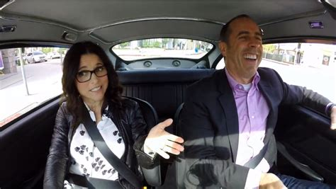Jerry Seinfeld and Julia Louis Dreyfus in an Aston Martin DB5 on Comedians in Cars Getting